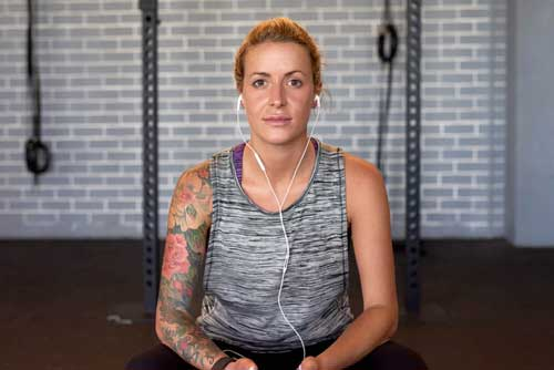 Woman with tattoos at the gym